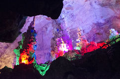 Stock image of beautiful illuminated multicolored stalactites from karst Reed Flute cave. Guilin Guangxi China Stock Photography