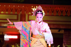 Stock image of a Beautiful Malay woman with traditional cloth performing a dance Royalty Free Stock Photography