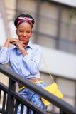 Stock image fashion model posing smiling on a stai Royalty Free Stock Photo