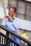 Stock image fashion model posing smiling on a stai Stock Photo