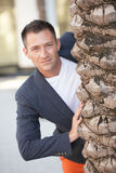 Stock image of a man behind a tree Stock Images