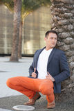 Stock image of a man posing by a tree Royalty Free Stock Photo