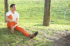 Stock image of a man sitting in the park Royalty Free Stock Photography