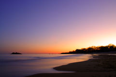 Stock image of Singing Beach Sunset. Singing Beach gets its name from the sand that sings when you walk on it. Actually, reports say that it's more of a squeak stock image