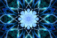 Stock image of Winter Kaleidoscope. Unusual background with winter kaleidoscope that looks like large snowflake , image created from photo of colored dandelion royalty free illustration