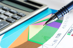 Financial graphs and charts analysis Stock Photography
