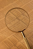 Stock index under magnifying glass Royalty Free Stock Image