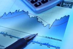 Stock investment. Stock chart with pen and calculator Royalty Free Stock Image