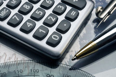 Stock investment analysis. With calculator and pen Royalty Free Stock Image