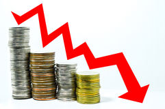 Stock investment bearish market concept red arrow downward trend line. On coin royalty free stock photos