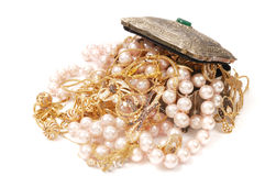 Stock of jewelry. Open metal box with gold jewelry and pearls Royalty Free Stock Photos