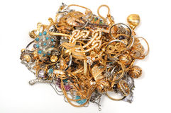 Stock of jewelry. Stock of gold jewelry on white background Stock Photos