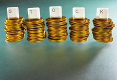 STOCK letter on gold coins stack Stock Photos