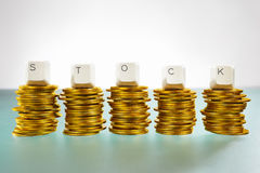 STOCK letter on gold coins stack stock image
