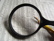Stock Market. Photo of Magnifying Glass and Stock Section of Newspaper - Part of Series stock photo
