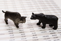 Stock market. Report with bull and bear royalty free stock photography