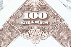 Stock market. 100 shares. Old stock share certificate. Vintage scripophily objects Royalty Free Stock Photos