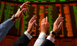 Stock market. Hands pushing a price on a stock market Stock Photo
