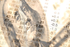Stock Market. Closeup of hundred dollar bill with stock chart in background showing losses and gains Royalty Free Stock Images
