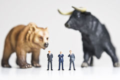 Stock market. Business figurines placed with bull and bear figurines Royalty Free Stock Photography