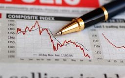 Stock Market Analysis. A ball pen on the business magazine, pointing to stock market performance index Stock Image