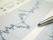 Stock market analysis. Stock market charts for investor analysis, using selective focus on graph and pen stock image