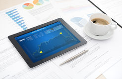 Stock market analytics on apple ipad Stock Image