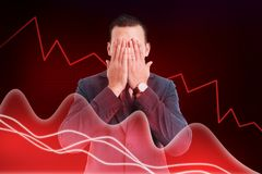 Stock broker covering eyes as blind to financial decline concept. Stock market broker covering both eyes with hands as blind to financial decline concept on red stock images