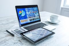 Stock market calculations and trading with a Tablet PC and Lapto. Stock market calculations with a calculator and research software on a Tablet PC with a Laptop Stock Photos