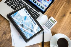 Stock market calculations and trading with a Tablet PC and Lapto. Stock market calculations with a calculator and research software on a Tablet PC with a Laptop Royalty Free Stock Image