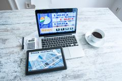 Stock market calculations and trading with a Tablet PC and Lapto. Stock market calculations with a calculator and research software on a Tablet PC with a Laptop royalty free stock photography
