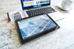 Stock market calculations and trading with a Tablet PC and Lapto. Stock market calculations with a calculator and research software on a Tablet PC with a Laptop royalty free stock photo