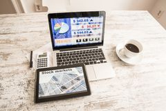 Stock market calculations and trading with a Tablet PC and Lapto. Stock market calculations with a calculator and research software on a Tablet PC with a Laptop Royalty Free Stock Photos