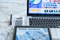 Stock market calculations and trading with a Tablet PC and Lapto. Stock market calculations with a calculator and research software on a Tablet PC with a Laptop Royalty Free Stock Images
