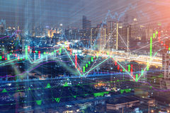 Stock market chart, Stock market data in blue on LED display con. Cept with city scape hong kong blur background Royalty Free Stock Photos