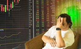 Stock market chart with stress man Royalty Free Stock Photo