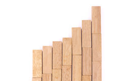 Stock Market Chart with the wood game (jenga). Stock Photography