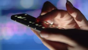 Stock market concept, trading online, trader working with smartphone on stockmarket trading floor. Woman touching screen. Browse foreign exchange market data stock footage