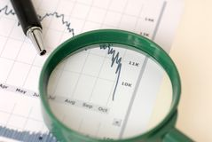 Stock market crash. Chart and magnifier stock photography