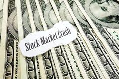 Stock Market Crash. Newspaper headline on hundred dollar bills Royalty Free Stock Photo