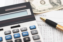 Stock market data analysis, with cash. Stock market data analysis with cash, and shallow depth of field to focus attention on the word'stocks stock photo