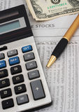 Stock market data analysis, financial. Stock market table analysis, calculator and pen indicates research and analysis, with cash, vertical orientation, cash stock photos