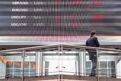 Stock market data displayed on a outdoor screen in Canary Wharf Stock Photography