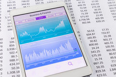 Stock market data and financial chart or graph on tablet Stock Image
