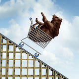 Stock Market Decline. Financial crisis concept as a bear in a shopping cart going down on a roller coaster structure as an investment metaphor and symbol for Stock Photos