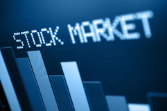 Stock Market Down. Stock Market - Column Going Down on Blue Display - Shallow Depth of Field stock photo