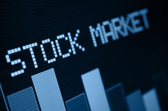 Stock Market Down. Stock Market - Column Going Down on Blue Display - Shallow Depth Of Field royalty free stock photos