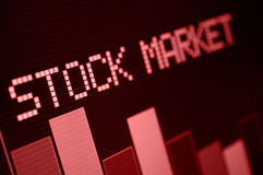 Stock Market Down. Stock Market - Column Going Down on Red Display - Shallow Depth Of Field royalty free stock photography