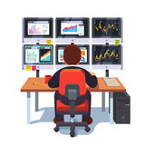 Stock market exchange trader working at desk Stock Photo