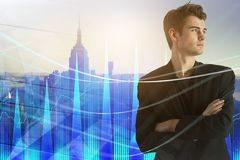 Stock market and finance concept. Portrait of thoughtful handsome european businessman standing on abstract city background with forex chart. Stock market and royalty free stock photo